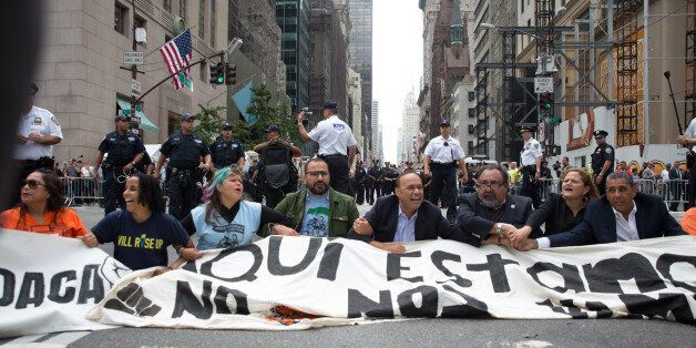 NEW YORK, NY - SEPTEMBER 19, 2017: Activists sit on Fifth Avenue in an action of civil disobedience near...