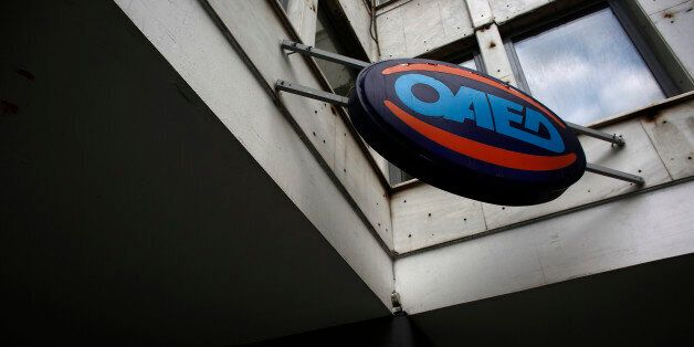 An OAED sign sits above the entrance to a job center in Athens, Greece, on Thursday, June 11, 2015. European...