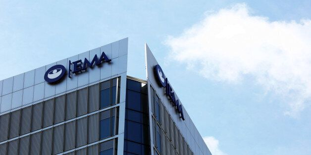 A sign hangs on the top of 30 Churchill Place, which houses the European Medicines Agency, stands in...