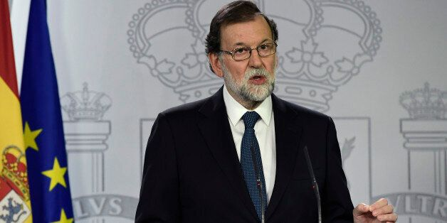 Spanish Prime Minister Mariano Rajoy speaks during a press conference at La Moncloa palace in Madrid...