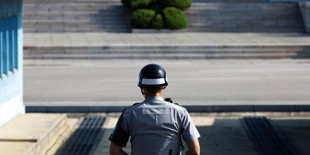 PANMUNJOM, SOUTH KOREA - SEPTEMBER 28: A South Korean soldier stands guard at the border village of Panmunjom...
