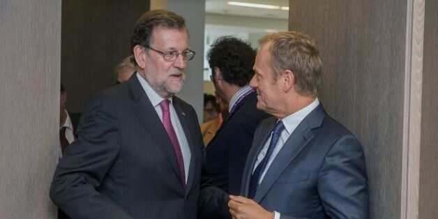 Spanish Prime Minister Mariano Rajoy (L) speaks with European Union Council President Donald Tusk ahead...