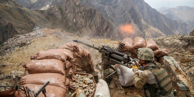 HAKKARI, TURKEY - AUGUST 15: A Turkish soldier fires his weapon at observation post during the operation...
