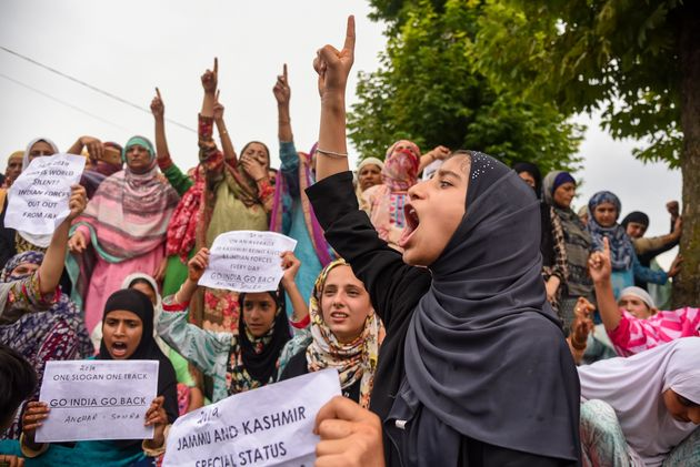 Kashmiri women chant slogans during the protest in Srinagar's Soura on August