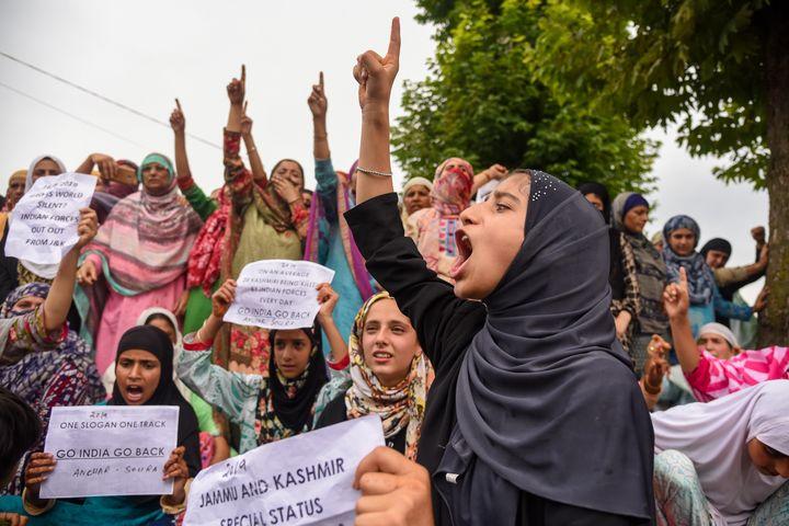 Kashmiri women chant slogans during the protest in Srinagar's Soura on August 31.