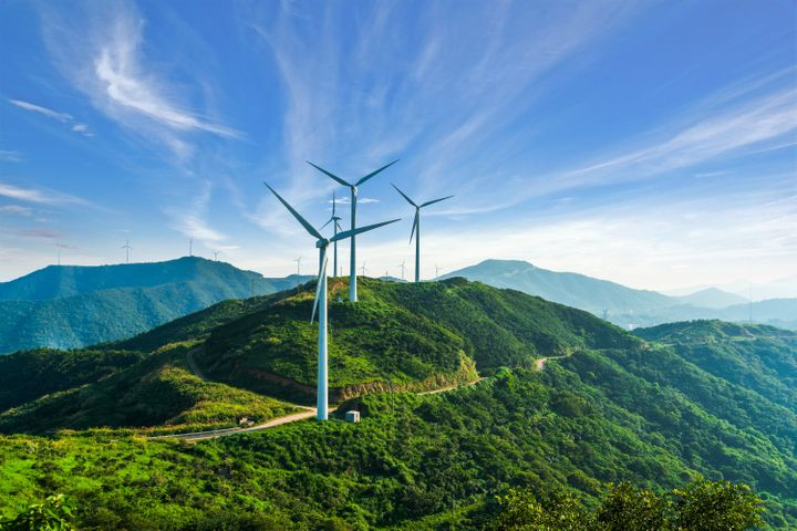 Wind turbines in Zhejiang province, China. In many places wind and solar power are already cheaper than fossil fuels.
