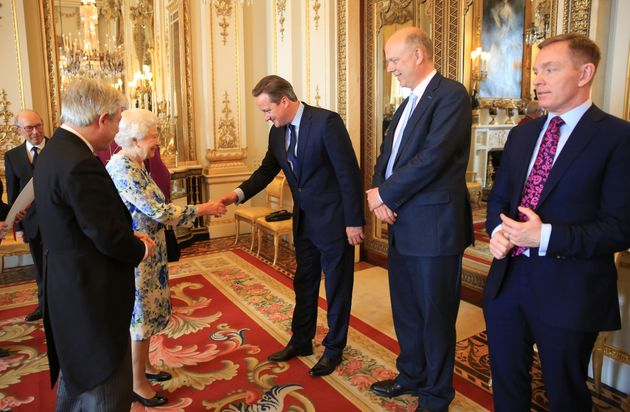 David Cameron greets the Queen in