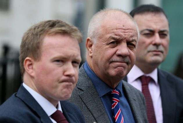 Victims campaigner Raymond McCord (centre) with his lawyers outside of the High Court in