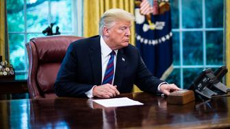 WASHINGTON, DC - AUGUST 27 : President Donald J. Trump listens to Mexican President Enrique Peña Nieto speak by phone as he announces that United States has reached an agreement with Mexico to enter a new trade deal in the Oval Office of the White House on Monday, Aug 27, 2018 in Washington, DC. (Photo by Jabin Botsford/The Washington Post via Getty Images)