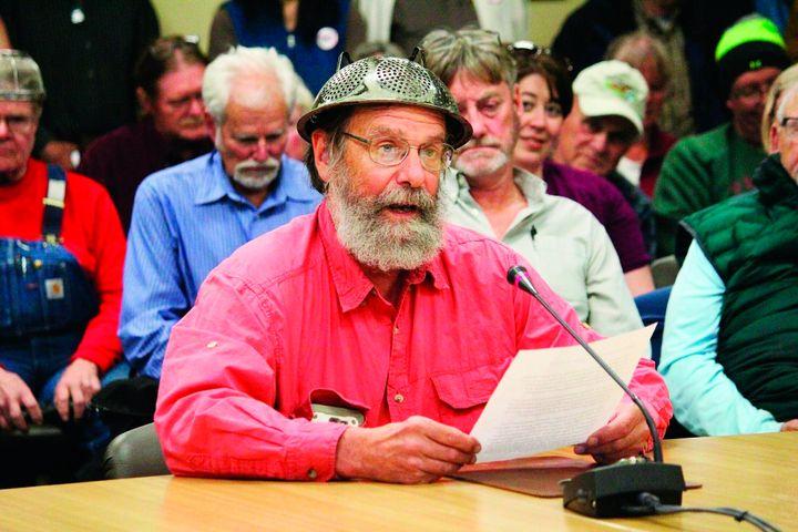 Fritz Creek area resident Barrett Fletcher gives the invocation before a Kenai Peninsula Borough Assembly meeting as a repres