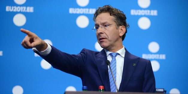 Jeroen Dijsselbloem, Dutch finance minister and head of the group of euro-area finance ministers, gestures...