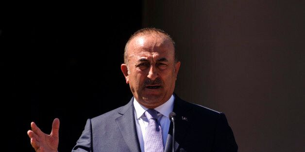 Turkish Foreign Minister Mevlut Cavusoglu speaks during a joint press conference with Turkish Cypriot...