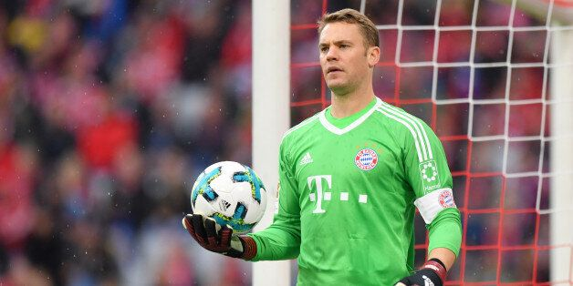 MUNICH, GERMANY - SEPTEMBER 16: Goalkeeper Manuel Neuer of FC Bayern Muenchen holds the ball during the...