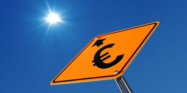 Yellow Euro prosperity ahead traffic sign on blue sky. Euro prosperity concept. Low Angle view. Horizontal...