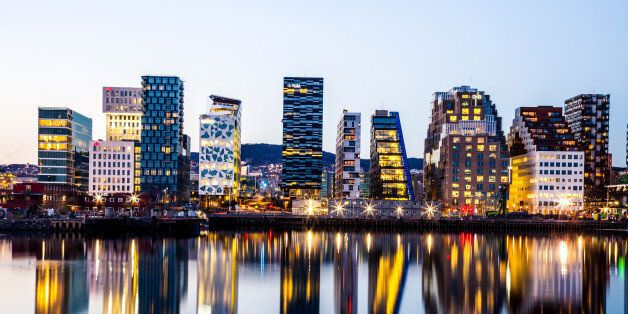 Oslo modern skyline. Several buildings built on the water's edge in the Norwegian capital city. Reflections on the water.