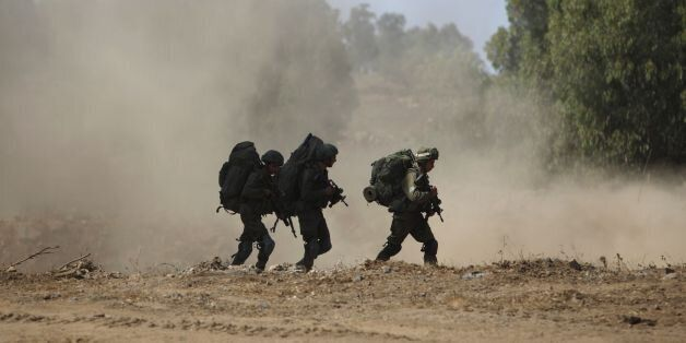 Israeli soldiers take part in a military exercise simulating conflict with Lebanese movement Hezbollah,...