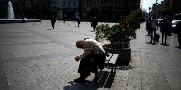 A man sits on a bench at Kotzia square in central Athens, Greece, March 22, 2017. REUTERS/Alkis