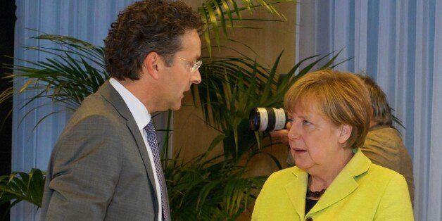 BRUSSELS, BELGIUM - JUNE 22: German Chancellor Angela Merkel (R) and Eurogroup President and Dutch Finance...