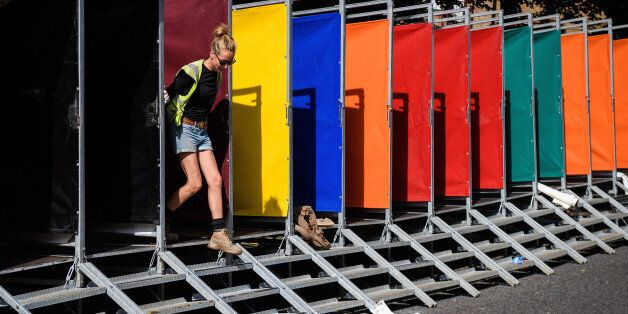 LONDON, ENGLAND - AUGUST 25: A woman helps build some of the hundreds of portable toilets, ahead of the...