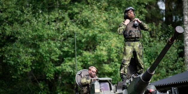 Swedish soldiers man a tank from Skaraborg's Swedish regiments practicing with a US-enhanced armored...