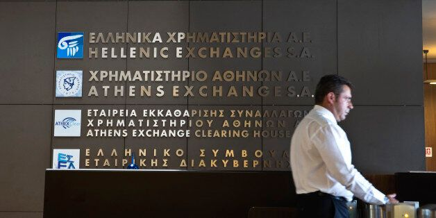 A security officer stands at the entrance to the Athens' stock exchange , Greece July 27, 2015. Greece's...