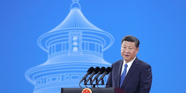 China's President Xi Jinping speaks during the 86th Interpol General Assembly at the Beijing National...