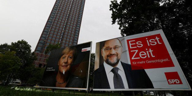A defaced election campaign poster of the Christian Democratic Union (CDU) party, with a headshot of...