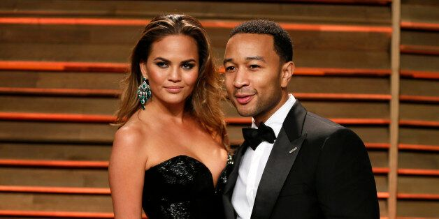 Singer John Legend and wife Chrissy Teigen arrive at the 2014 Vanity Fair Oscars Party in West Hollywood, California March 3, 2014. REUTERS/Danny Moloshok (UNITED STATES TAGS: ENTERTAINMENT) (OSCARS-PARTIES)