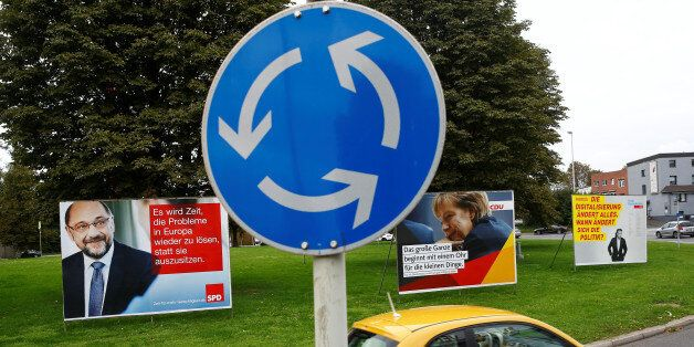 A street sign for a roundabout stands in front of election campaign posters of Martin Schulz of Germany's...