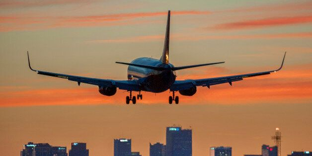 Twilight, when day turns to night. Commercial airplane coming in for landing in