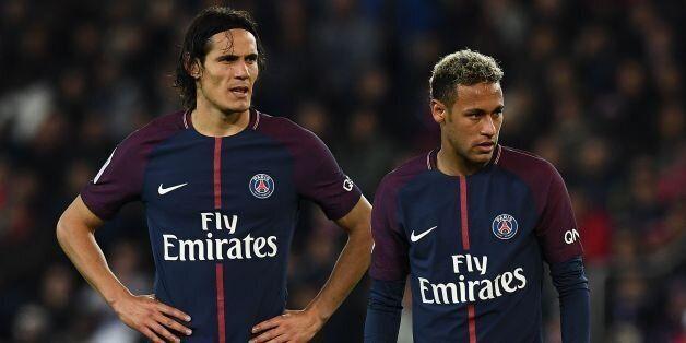 TOPSHOT - Paris Saint-Germain's Uruguayan forward Edinson Cavani (L) and Paris Saint-Germain's Brazilian...