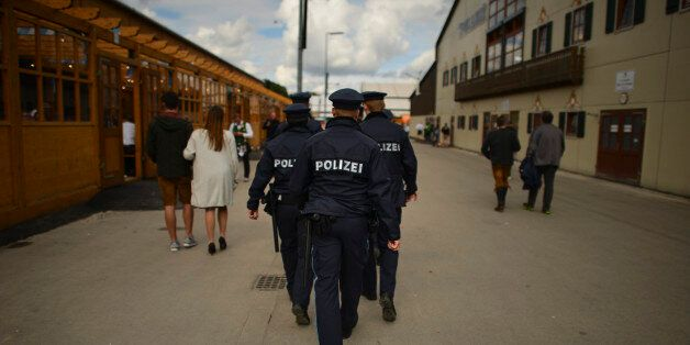 MUNICH, GERMANY - SEPTEMBER 17: A group of policemen patrols the fairground on the second day of the...