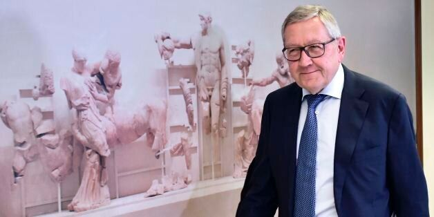 Managing Director of the European Stability Mechanism Klaus Regling walks towards a meeting with Greece's...