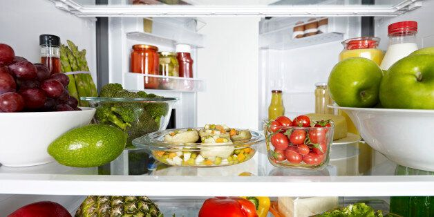 Fridge full of fruits, vegetables and diary products.
