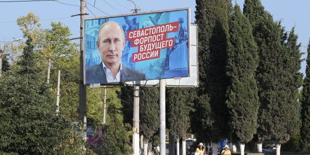 SEVASTOPOL, CRIMEA - AUGUST,19 (RUSSIA OUT) A giant poster with portrait of Russian President Vladimir...