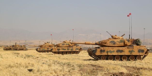 Turkish tanks are seen near the Habur crossing gate between Turkey and Iraq during a military drill on...