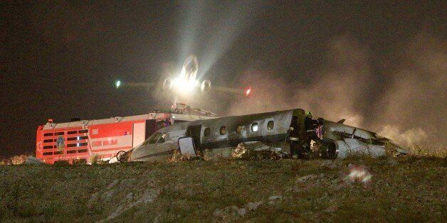 ISTANBUL, TURKEY - SEPTEMBER 21: Firefighters extinguish a private jet that skidded off and crashed on...