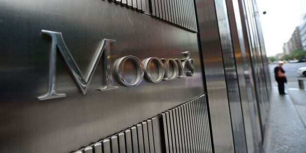 A sign for Moody's rating agency stands in front of the company headquarters in New York, September 18,...