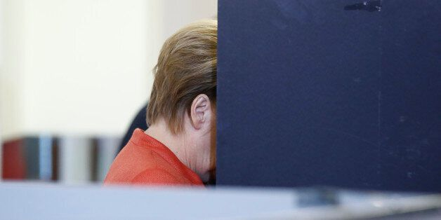 German Chancellor and CDU party leader Angela Merkel casts her ballot at a polling station on September...