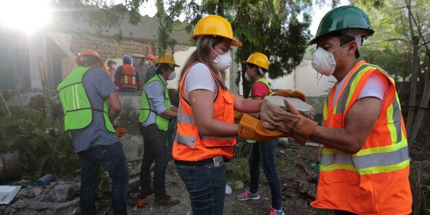 VALLE DE VAZQUEZ, MEXICO - SEPTEMBER 23: Volunteers work removing debris from a collapsed house four...
