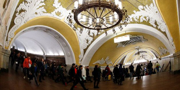 People walk inside Komsomolskaya metro station in Moscow, Russia, March 22, 2017. REUTERS/Grigory
