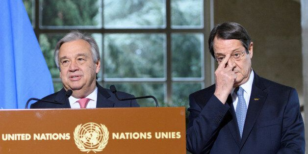 UN Secretary-General Antonio Guterres (C) speaks next to Greek Cypriot President Nicos Anastasiades (R)...