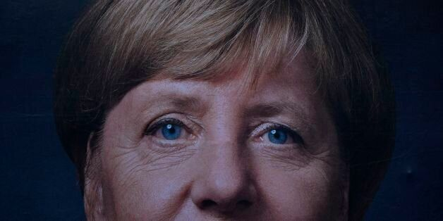 A billboard featuring German Chancellor and leader of the conservative Christian Democratic Union (CDU)...