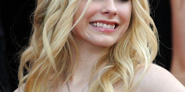 Canadian singer Avril Lavigne arrives for a screening of U.S. directors Karey Kirkpatrick and Tim Johnson's...