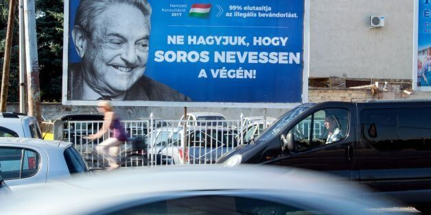A poster with US billionaire George Soros is pictured on July 6, 2017 in Szekesfehervar, Hungary.The...