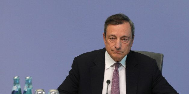 Mario Draghi, president of the European Central Bank (ECB), pauses during a news conference following...