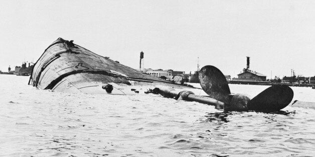 (Original Caption) Target Ship was Japs' Target. Washington, D.C.: The U.S.S. Utah is shown capsized...