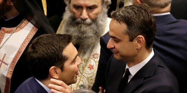 ATHENS, GREECE - MAY 31 : Prime Minister of Greece Alexis Tsipras (L) offers his condolences to son of...