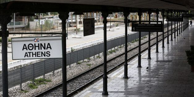 A man walks along an empty platform at a closed central train station during a 24-hour labour strike...