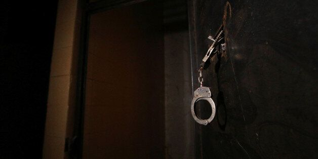 Handcuffs are pictured inside a prison, which according to Syria Democratic Forces (SDF) fighters belonged...